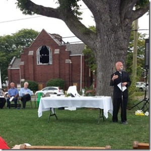 Pastor Jimmy Madsen preaching at Sunday's outdoor service.