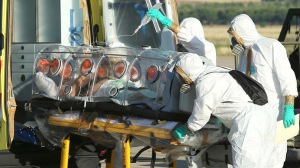 A handout picture taken and released on August 7, 2014 by the Spanish Defense Ministry shows Roman Catholic priest Miguel Pajares, who contracted the deadly Ebola virus, being transported from Madrid's Torrejon air base to the Carlos III hospital upon his arrival in Spain. (AFP Photo)