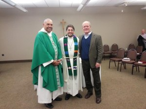 The Rev. Karl Biermann (center) was installed as Assistant to the Bishop.