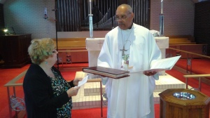 The parish records are handed to the bishop.