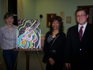 Worship & Music Chair Jen Dobush, artist Lorraine Johnson-Davis, and Patrick Parker at opening of Bach Concert and Art Gallery in 2010.