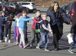Police lead children away from Sandy Hook Elementary. AP Photo/Newton Bee/Shannon Hicks