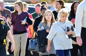 Survivors are evacuated from the scene of a shooting on December 2, 2015 in San Bernardino, California. FREDERIC J. BROWN/AFP/Getty Images)