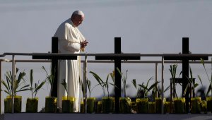 Pope Francis stands a platform near the U.S.-Mexico border fence along the Rio Grande, in Ciudad Juarez, Mexico. (AP Photo/Eric Gay)