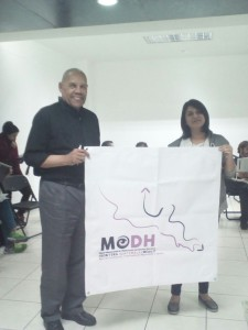 Alaide and me hold up the mission logo.